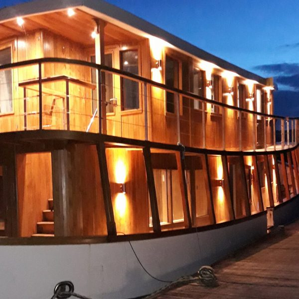 The Highland Lassie Cruises boat lit up at night