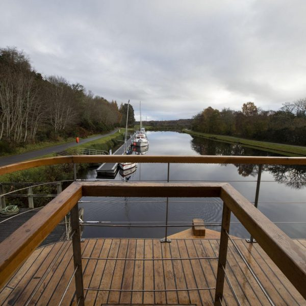 A view down the Caledonian Canal from the upper level stern of the Highland Lassie boat.