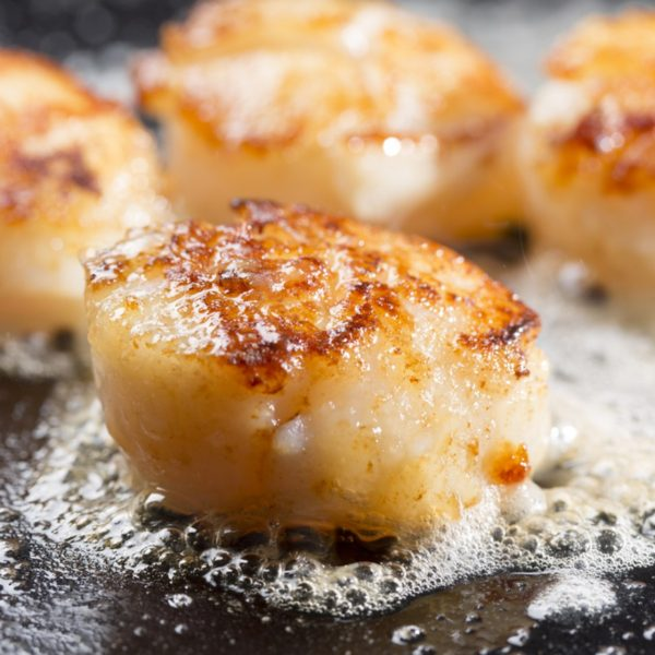 Scottish Scallops sizziling in butter served on a slate