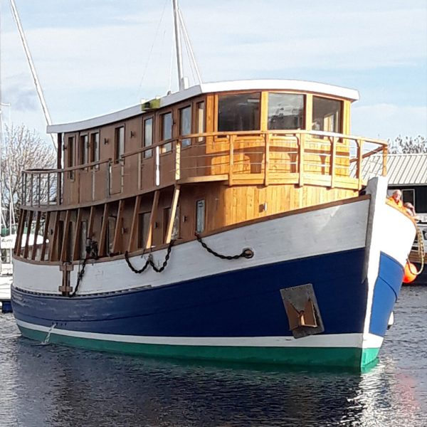 The Highland Lassie Cruises boat moored in dock