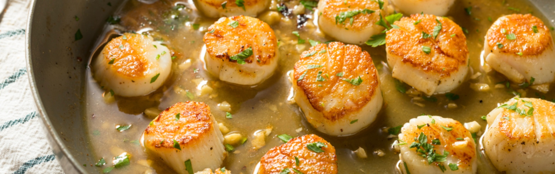 Delicious Scottish Scallops sizziling in butter